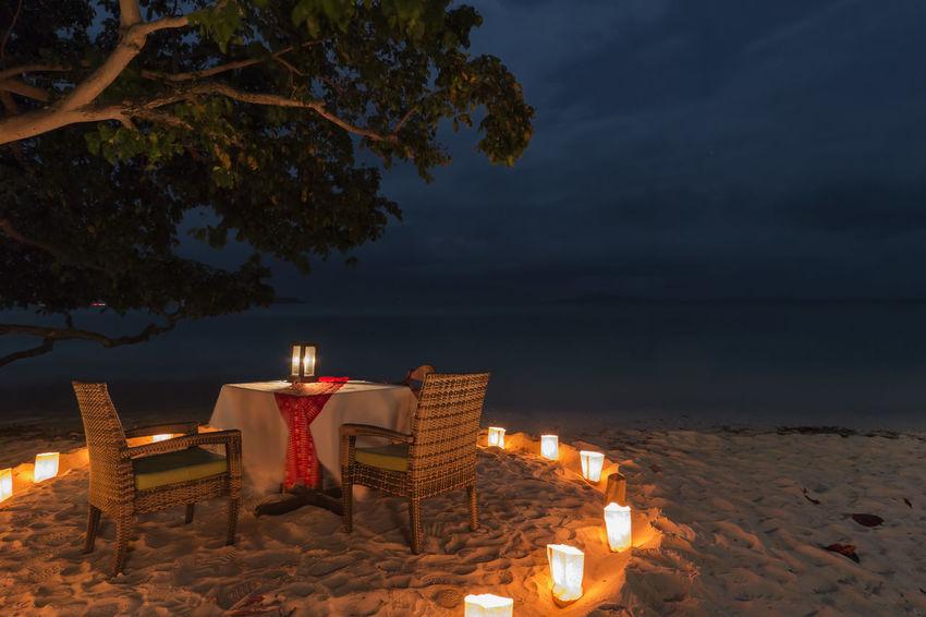 Romantic dinner on a beach of Phi Phi Don Island in Krabi, Thailand Ao Nang Infinity Pool Krabi Luxury Hotel Maya Bay Railay Thailand Beach Losama Bay Palm Trees Paradise Phi Phi Island Resort Summer Water