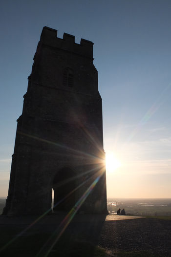 Evening light on Glastonbury Tor England, UK English Countryside Glastonbury Historical Building Historical Monuments Historical Sights Sacred Places Sacred Place Architecture Building Building Exterior Built Structure Glastonbury Tor History Lens Flare Lens Flare Sun Mysterious Outdoors Sacred Site Sunbeam Sunlight Sunset Tourism Tower Travel Destinations