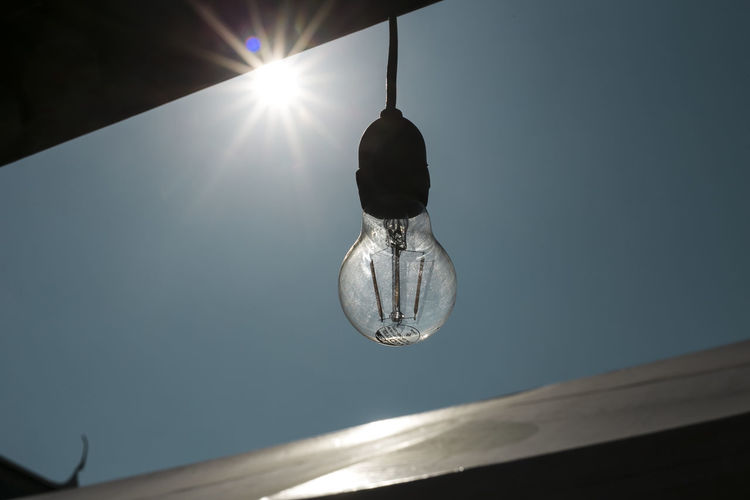 Sunlight Low Angle View Hanging Sky Lighting Equipment Nature No People Sun Illuminated Electricity  Light Bulb Light Day Sunbeam Outdoors Lens Flare Bright Glass - Material Sunny Light - Natural Phenomenon Ceiling
