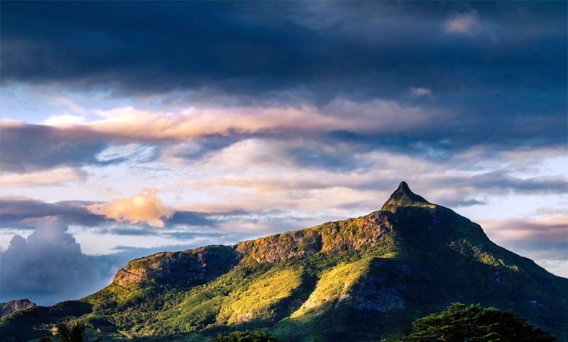 """Iconic mountain peak """"Le Pouce"""". I still can't believe I get to see this view everyday from my window. Mauritius Photography Colors Colorful Colour Of Life Majestic Gradient EyeEm Ready   History Travel Destinations Sunset Ancient Outdoors Tourism Mountain Cloud - Sky Landscape No People Sky Nature Scenics Beauty In Nature"""