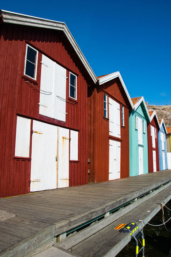 Fisherman huts against clear blue sky