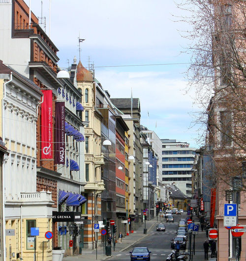 One of the main streets in Oslo, Norway Department Stores Oslo, Norway Architecture Parking In Oslo Built Structure City Day No People Oslo Norway Outdoors Road Signs Sky Tree Shopping In Oslo