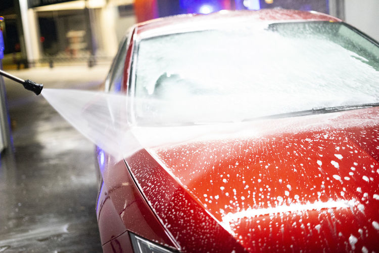 Close-up of wet glass of car