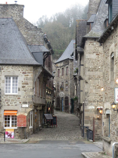 Vieille rue déserte Old deserted street Architecture Brittany Building Exterior Built Structure City Cobbled Street Côtes D'Armor Dinan France No People Old City Old House Outdoors Quiet Shop