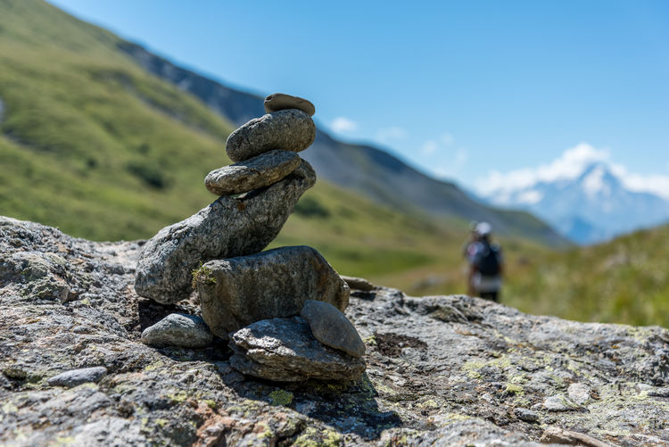 Cairn in the french Alps showing a track to follow (called GR in France), Alps, France, Europe Trekking Balance Beauty In Nature Day Environment Focus On Foreground Glacier Land Landscape Mountain Mountain Peak Nature No People Non-urban Scene Outdoors Rock Rock - Object Scenics - Nature Sky Solid Stack Stone - Object Tranquil Scene Tranquility Travel Destinations