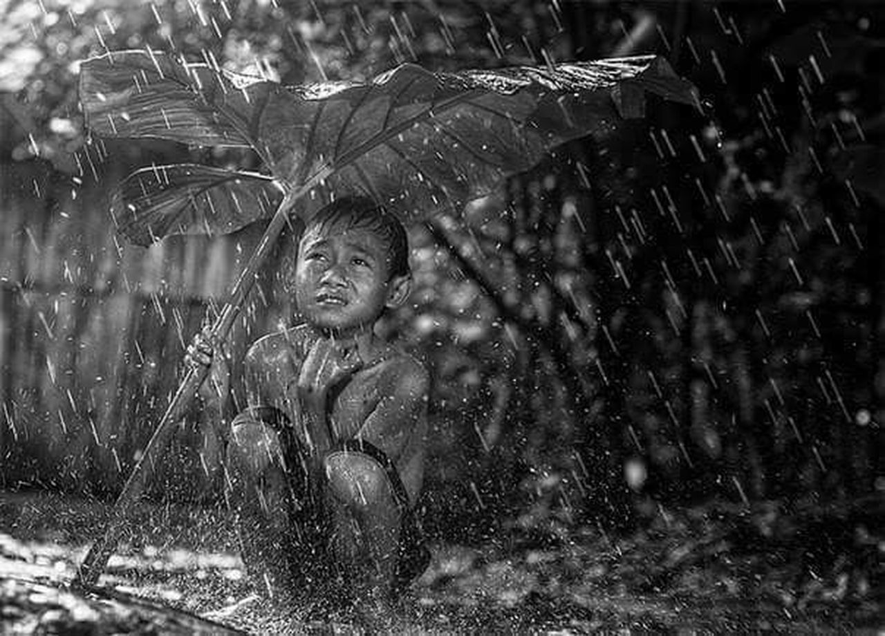 water, rain, wet, fun, outdoors, happiness, motion, one person, day, smiling, children only, cheerful, nature, childhood, people, portrait, young adult