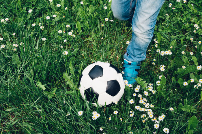 Ball Boy Child Close-up Flowers Grass Grass Healthy Human Body Part Human Leg Leisure Leisure Activity Lifestyle Low Section One Person Outdoors Run Scoring A Goal Soccer Soccer Ball Soccer Player Sport Sports Young