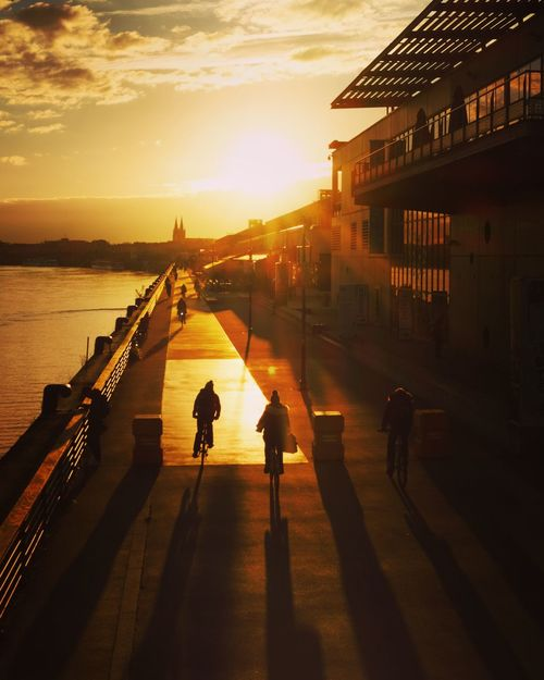 GroWing shadoWS Architecture Built Structure Real People Sunset Building Exterior Silhouette Sunlight Sky Lifestyles Men Walking Leisure Activity Outdoors Shadow Women Full Length Sea City Nature Day Beauty In Nature Nature EyeEm Masterclass EyeEmNewHere EyeEm Best Shots