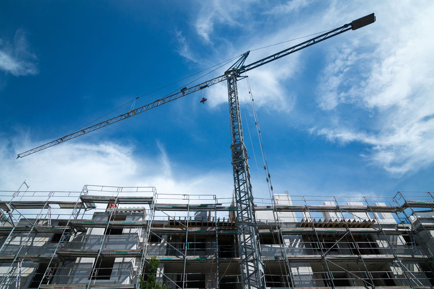Typical German construction site Baugerüst GERMANY🇩🇪DEUTSCHERLAND@ Kran Low Angle View Architecture Blue Blue Sky And Clouds Building Exterior Built Structure Cloud - Sky Crane - Construction Machinery Day High Crane Low Angle View No People Outdoors Scaffold Sky Tall Buildings White