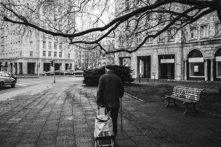 Adult Adults Only Architecture Bare Tree Blackandwhite Blackandwhite Photography Building Exterior Built Structure City City Life Day Grandpa Karl Marx Allee Men Old People One Man Only One Person Only Men Outdoors People Real People Rear View Stralauer Allee Street Tree