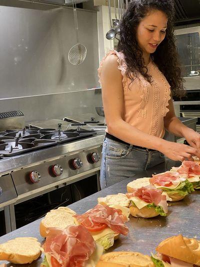 Young woman preparing food at home