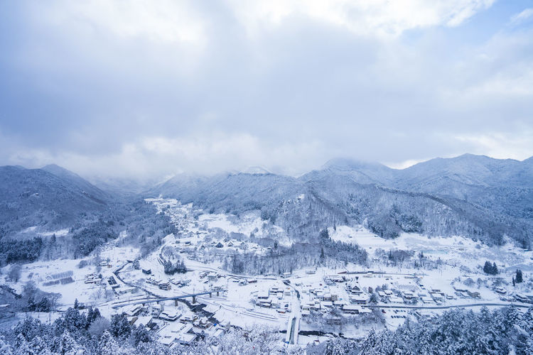 Cloud - Sky Scenics - Nature Winter Landscape Sky Mountain Snow Cold Temperature Beauty In Nature Environment Nature Mountain Range Tranquil Scene No People Architecture City Tranquility Travel Destinations Outdoors Snowcapped Mountain
