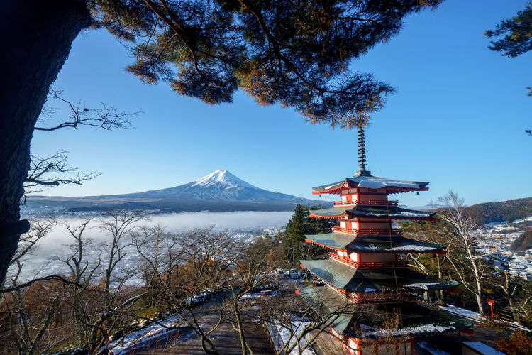 Mt. Fuji with red pagoda, Fujiyoshida, Japan Beauty In Nature Blue Day First Eyeem Photo Foggy Morning Fujiyoshida Full Frame Kawaguchiko Landscape Mountain Nature No People Outdoors Pagoda Temple Scenics Sky Snoe Travel Travel Destinations Tree Tree, Tower, Spring, Autumn, Travel, View, Day, Landmark, Mount, Skyline, Lake, Twilight, Asia, Season, Tourist, Historic, Cherry, Sightseeing, Mt, Fall, Temple, Panorama, Festival, Mountain, Sunset, Pagoda, Sky, Fuji, Boat, Tokyo, Beautiful, Water, Shint Volcano Water Winter