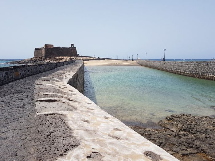 The fortress Seascape Sea Fortress Castle Canary Islands Lanzarote Water Beach Sky Sea Clear Sky Nature Land Day Tranquil Scene Tranquility Sand Scenics - Nature Beauty In Nature No People Sunlight Architecture Outdoors Built Structure