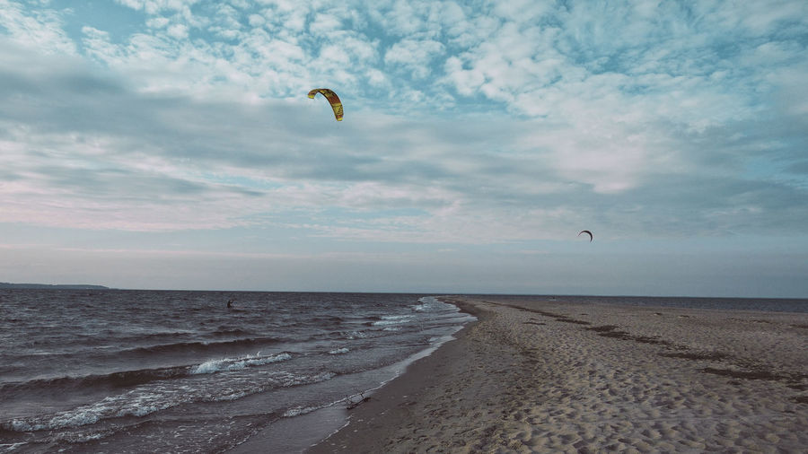 Panorama view to the beach and sea with kitesurfers