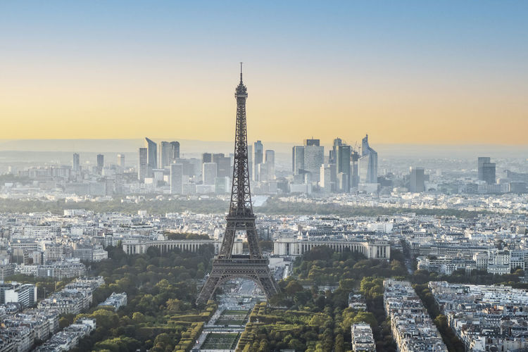 Aerial view of paris at sunset with the eiffel tower in background