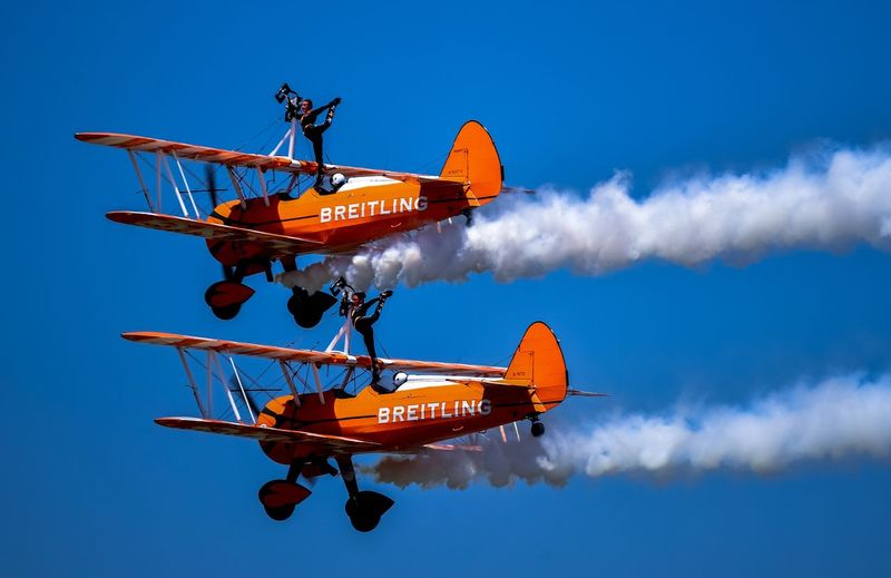 Breitling Transportation Airshow Blue Air Vehicle Mode Of Transport Sky Low Angle View Technology Flying Airplane Outdoors Day Clear Sky No People Aerobatics Stunt