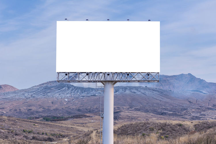 Advertisement Beauty In Nature Billboard Blank Blue Communication Copy Space Day Environment Land Landscape Mountain Nature No People Outdoors Placard Scenics - Nature Sign Sky Tranquility