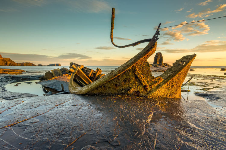 Wreck of the fishing trawler Admiral Von Tromp at Saltwick Bay near Whitby, North Yorkshire, England. Admiral Von Tromp Coastline Landscape England, UK Saltwick Bay Saltwick Nab Whitby North Yorkshire Abandoned Damaged Deterioration Disaster Golden Light Low Tide Nautical Vessel North Yorkshire Coast Saltwick Bay Sea Ship Shipwreck Sunrise