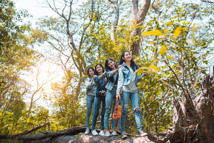 Group of Asian women walking enjoy travel trekking in vacation time for go to camping. Tree Plant Child Togetherness Group Of People Full Length Women Men Childhood Girls Boys Nature Offspring Males  Day Autumn Leisure Activity Females Family Standing Sister Outdoors Son Positive Emotion Daughter
