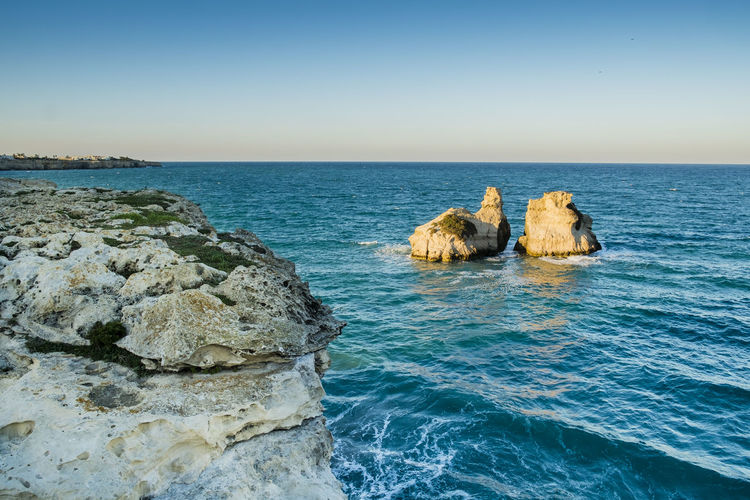 Two Sisters - Melendugno - Lecce - Italy Beach Beauty In Nature Blue Clear Sky Coast Day Horizon Over Water Italy Landscape Nature No People Outdoors Rock - Object Rock Formation Rocks And Water Salento Scenics Sea Sea And Sky Sea View Sky Tranquil Scene Tranquility Travel Destinations Water