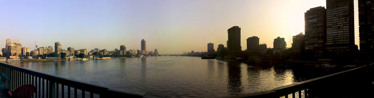 Cairo Connected By Travel Egypt Nile River Africa Architecture Building Exterior Built Structure City Cityscape Modern Nilo No People Outdoors Reflection River Sky Skyline Skyscraper Sunset Tower Travel Destinations Urban Skyline Water Waterfront