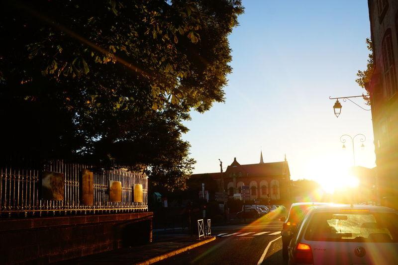 Sun shining through car on street
