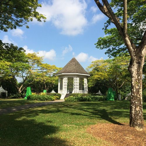 Low angle view of gazebo in park against sky