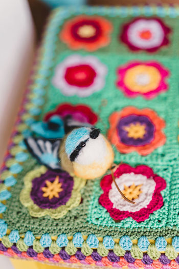 Craft Items Craftsmanship  Vintage Craft Arts And Crafts Textile Art And Craft Close-up Animal Themes Multi Colored Wool Indoors  Animal Creativity No People Selective Focus One Animal Animal Representation Body Part Representation Pattern Knitted  Crochet Turquoise Colored Softness Floral Pattern