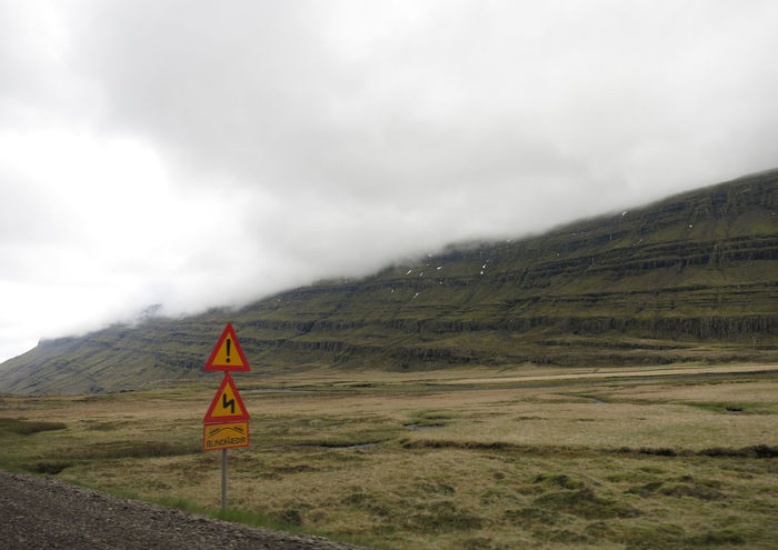 Beauty In Nature Cloudy Day Day Iceland Road Conditions Roadtrip Adventures Sloping Road Traffic Sign