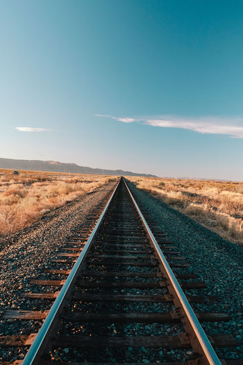 Railroad tracks in West Texas Sky Rail Transportation Diminishing Perspective Track vanishing point Direction Railroad Track Transportation Nature The Way Forward Landscape Scenics - Nature No People Environment Beauty In Nature Horizon Cloud - Sky Day Land Tranquil Scene Straight Long Parallel