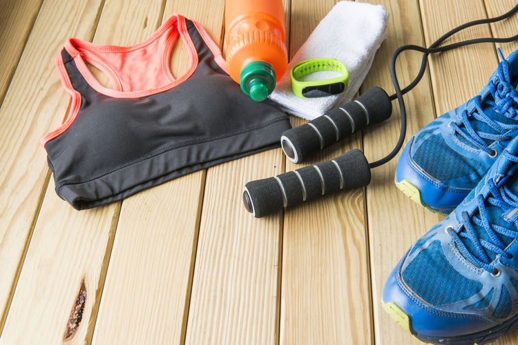 Close-Up Of Sports Equipment On Wooden Table