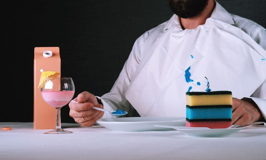 Midsection Of Man With Having Food On Table
