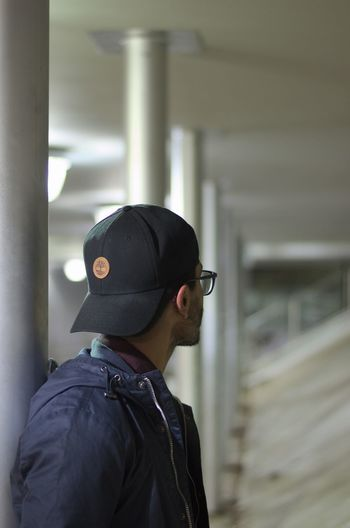 Architecture Built Structure Cap Day Emotional Focus On Foreground Indoors  Jacket Looking Away Looking Out Men One Person Real People Young Adult