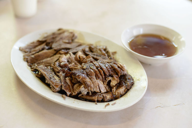 Close-Up Of Braised Duck Served In Plate On Table