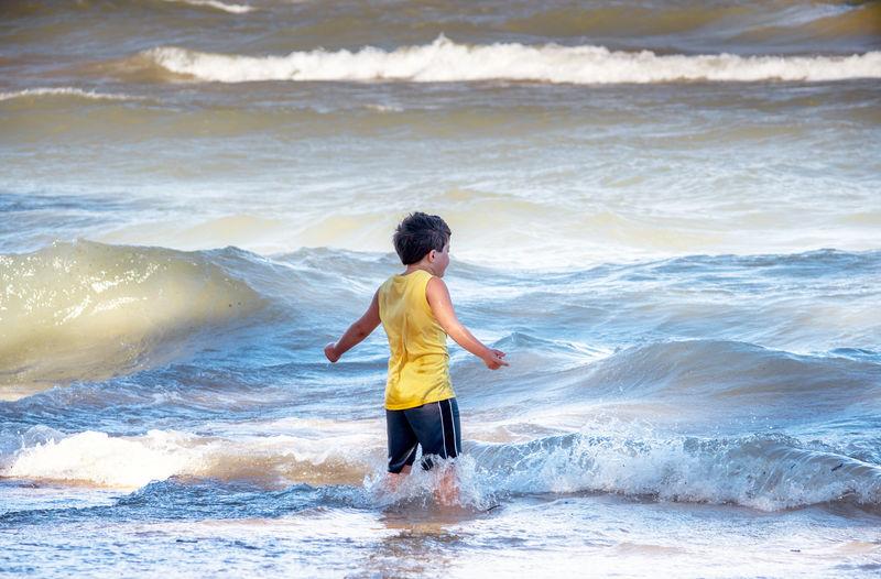 Full length of man standing on beach