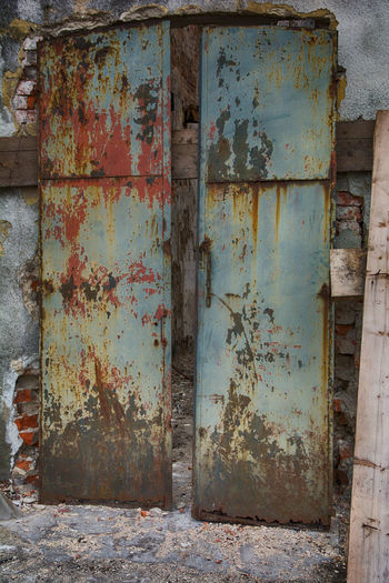 Weathered Rusty Old Abandoned Entrance Metal Door Wood - Material Architecture Built Structure Container Obsolete Damaged Wall - Building Feature Deterioration Industry Outdoors No People
