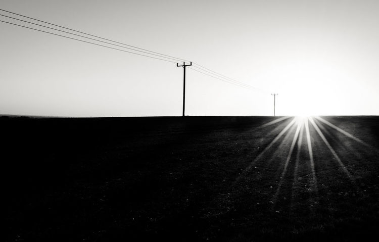 """""""Simple & Minimalistic"""" Sunset Sun Star Shadow Lens Flare BW Landscape Bw_collection Minimalism Telephone Line Alone Rural Scene Lost In The Landscape Landscape Nature Day Telephone Line Beauty In Nature Outdoors No People Connection"""