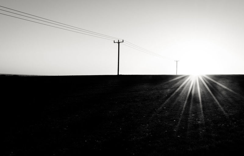 """Simple & Minimalistic"" Sunset Sun Star Shadow Lens Flare BW Landscape Bw_collection Minimalism Telephone Line Alone Rural Scene Lost In The Landscape Landscape Nature Day Telephone Line Beauty In Nature Outdoors No People Connection"