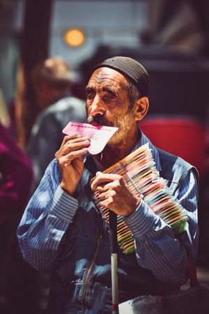 Bazaar Iranian Live For The Story Man Old Man Day Focus On Foreground Grand Bazaar Headwear Holding Iran Iran Street Photography Leisure Activity Lifestyles One Person Outdoors People People And Places People Photography Person Portrait Real Life Real People Real Photography Senior Adult