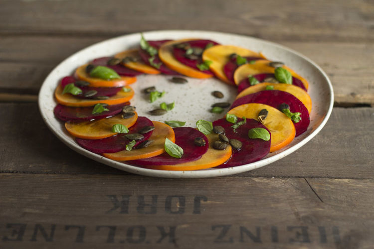 Veggie Carpaccio with beetroot and persimmon! Basil Food And Drink Retro Salad Vegetarian Food Beetroot Carpaccio Close-up Food Food And Drink Foodphotography Healthy Italian Food Persimmon Plate Ready-to-eat Table Vegan Wood - Material