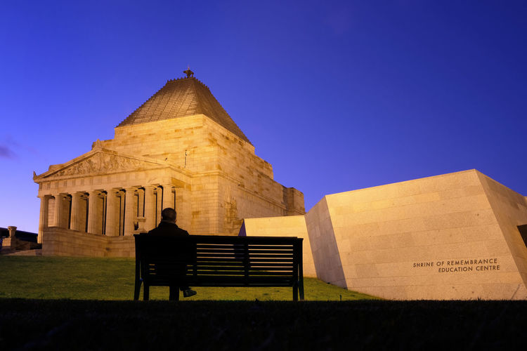 Shrine Of Remembrance Silhouette Architecture Bench Building Building Exterior Clear Sky History Low Angle View Melbourne Men Night Single Man Sitting Sky Capture Tomorrow The Architect - 2019 EyeEm Awards