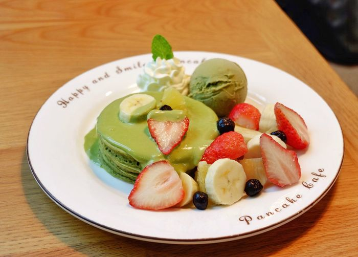 Greentea pancake with fruit such as banana ,strawberry and blueberry ,ice cream and whipped cream Restaurant Travel Cafe Breakfast Healthy Pancake Pancakes Sweet Shop Restaurant Wooden Wood Greentea Sauce Blueberry Banana Strawberry Dessert Food And Drink Food Healthy Eating Fruit Plate Freshness Berry Fruit Table Sweet Food SLICE Close-up Serving Size