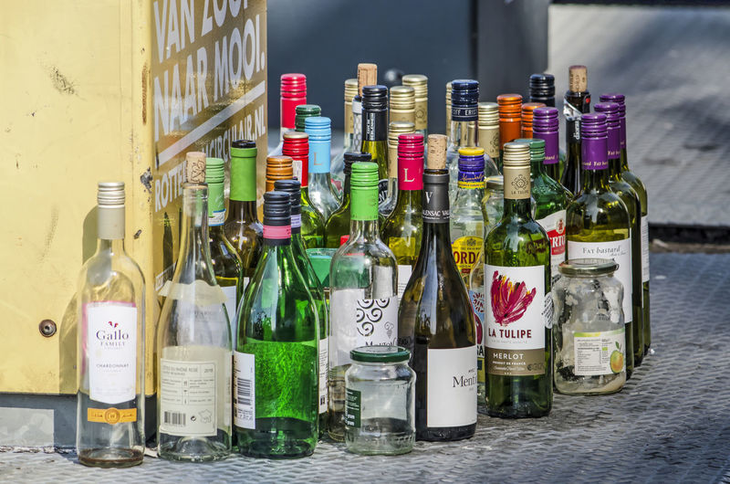 Row of wine bottles on table