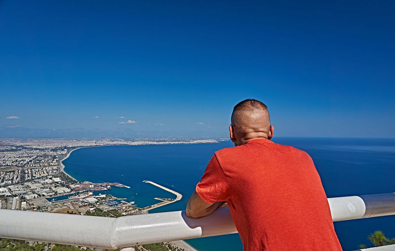 Antalya Antalya Turkey Panoramic View Beauty In Nature Blue Day Horizon Horizon Over Water Landscapes Leisure Activity Lifestyles Looking At View Men Nature One Person Outdoors Real People Rear View Scenics - Nature Sea Sky Standing Sunlight Three Quarter Length Water