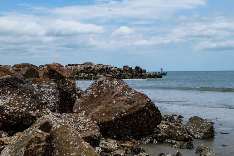 Rock near the see .. Just interested Sea Beach Water Horizon Over Water No People Nature Vacations Sand Outdoors Travel Destinations Sky Day Beauty In Nature Stone Material Rock - Object Rock Sea And Sky Thaistyle Cloud - Sky Landscape Travel Sunny Day Nature Thailandtravel
