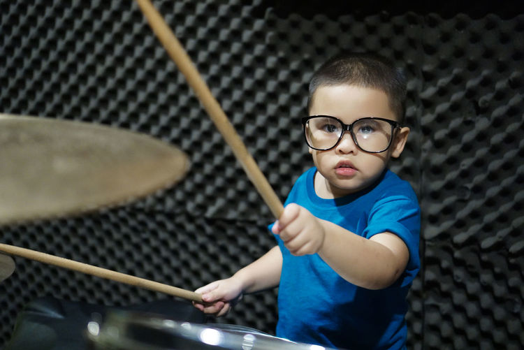 Portrait of boy playing drums