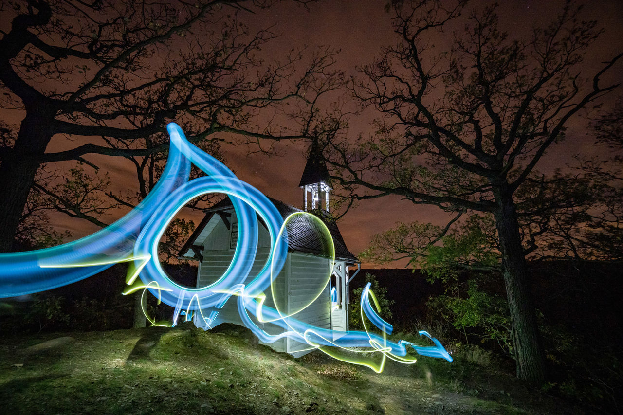 tree, illuminated, plant, night, long exposure, nature, no people, playground, multi colored, bare tree, light painting, branch, park, motion, park - man made space, glowing, outdoor play equipment, land, outdoors