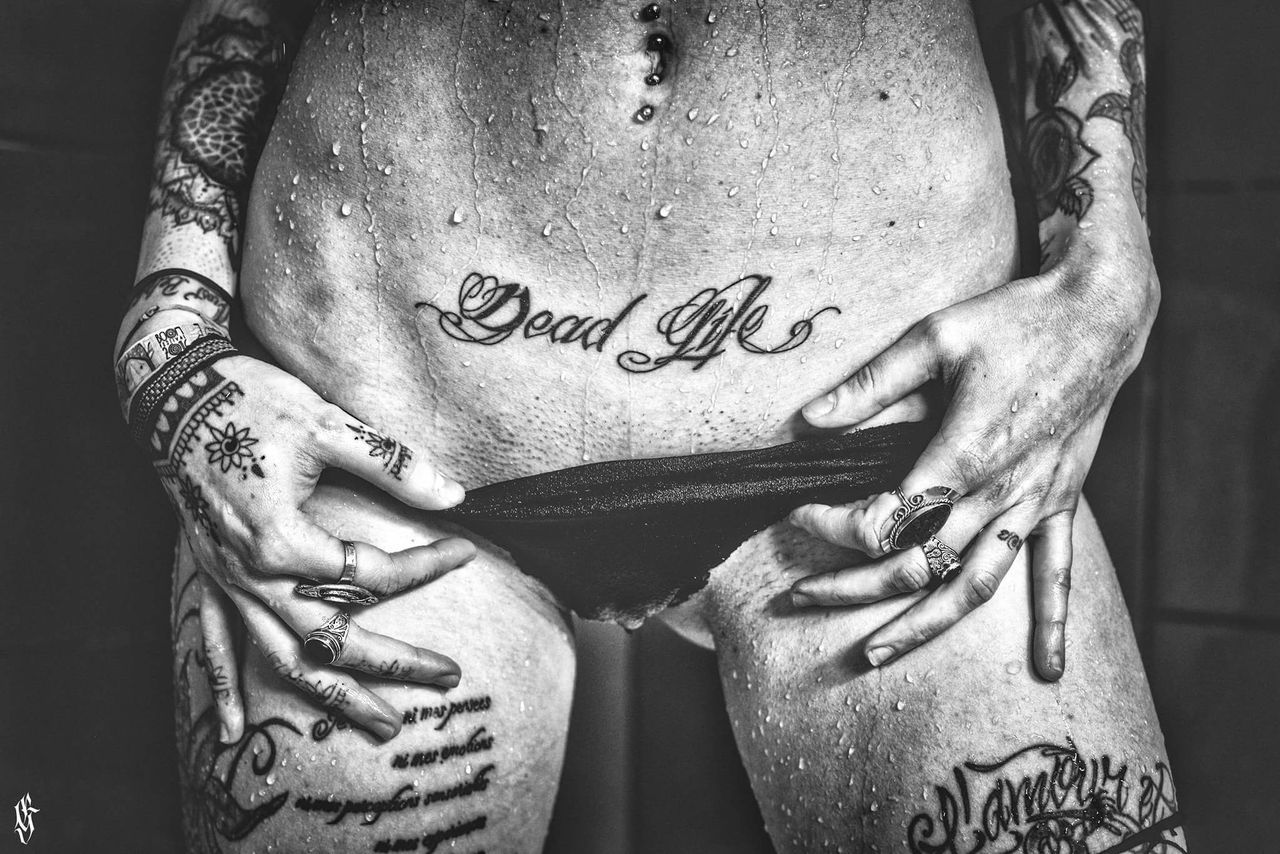 midsection, text, tattoo, shirtless, love, close-up, men, front view, real people, one person, indoors, lifestyles, bonding, human body part, human hand, belly, stomach, abdomen, one man only, day, adult, adults only, people