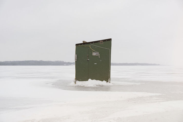 Alone Frozen Green Ice Fishing Quiet Winter Cold Cold Temperature Empty Fishing Hut Ice Fishing Huts Minimalism One Person Snow Spooky White Wind